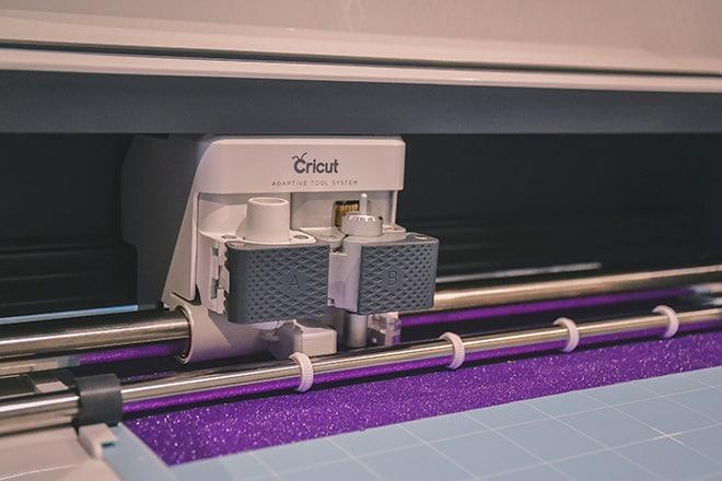 Cricut Maker in action cutting premium permanent vinyl
